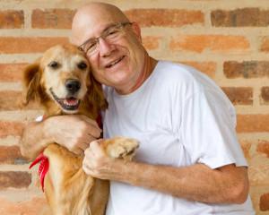 older-man-with-golden-retriever-dog