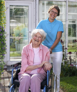 caregiver with wheelchair bound woman