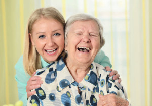 female -caregiver-with-senior-woman-600w home care greenville sc
