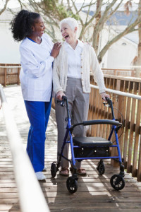 woman with walker and caregiver cognitive care
